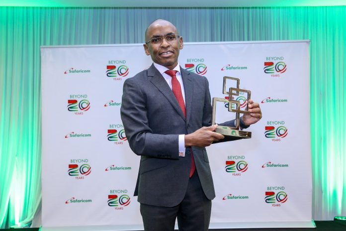 Safaricom CEO, Peter Ndegwa, poses for a photo with the GSMA Outstanding contribution to the mobile industry award.