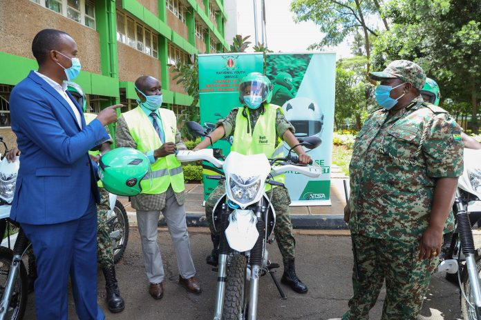 L – R; Micah Kenneth - Regional Manager, Bolt East Africa hands over a helmet and a reflective jacket to George Njao- Director General at NTSA and Matilda Sakwa – Director General at National Youth Service (NYS) during a handover ceremony of safety gears at the NYS headquarters in Nairobi. Bolt donated over 120 safety gears including helmets, reflective jackets and first aid kits to NTSA and NYS as part of its support and contributions towards the National Government Boda Boda Rider Training Programme launched in February 2021 to address the increasing road safety challenges in the Boda Boda Sector.