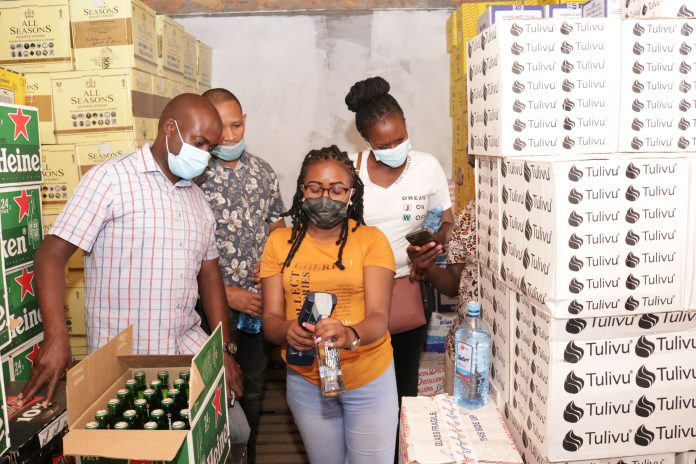 KRA investigations and enforcement officers verify excise duty stamps affixed to liquor in one of the shops in Nairobi on Saturday 1st May 2021. Illicit liquor worth KShs.1.4 million with an estimated tax value of KShs.657,343 were seized during the crackdowns.