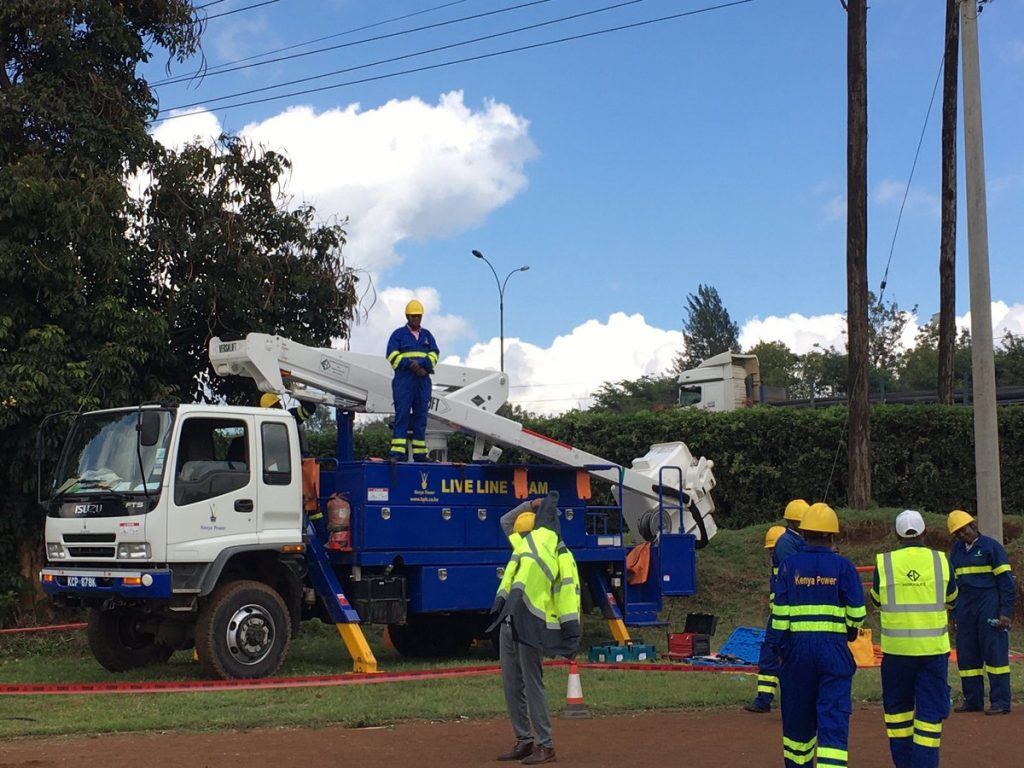 Kenya Power technicians at work. The National Fibre Optic Backbone project was initiated by former President Mwai Kibaki's administration in 2007.