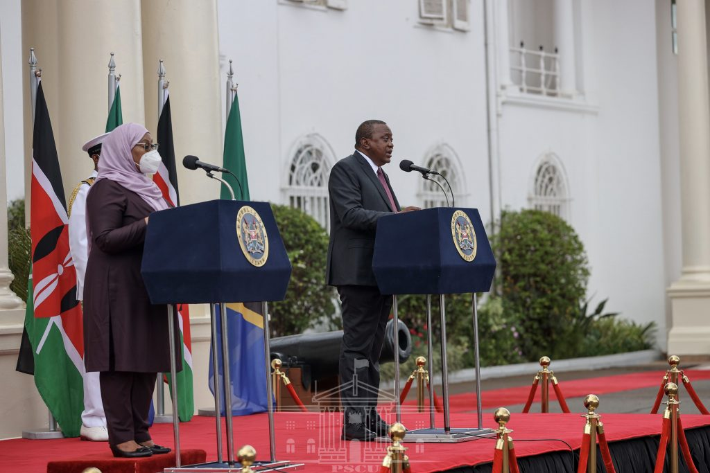 Presidents Samia Suluhu and Uhuru Kenyatta address a joint press conference on May 4, 2021. They agreed to eliminate barriers to smooth trade flows between the two countries.