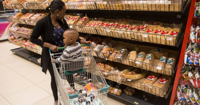 A shopper looks at bread at a supermarket. Several bread manufacturers have been found violating numerous regulatory standards following an investigation by the Competition Authority of Kenya (CAK).