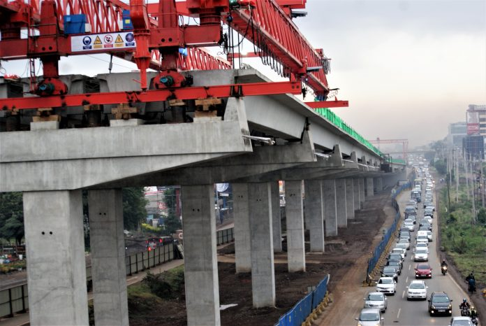 A section of Nairobi with construction of the Expressway in the background. The online construction approval platform is to be upgraded in the next financial year ending June 30, 2022.