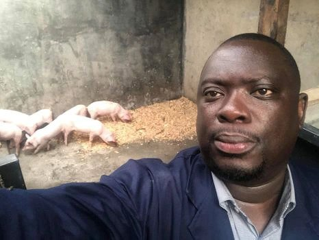 Mike Njenga takes a selfie with piglets at his farm. He is involved in several ventures. [Photo/ Mike Njenga]
