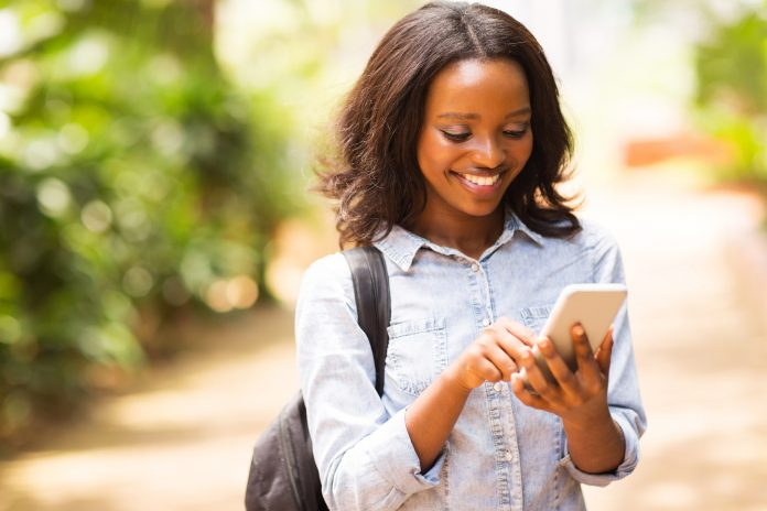 A woman uses her smartphone. Samuel Thuo hopes to make it easier for young Kenyans to save, invest and manage their finances with the Smart Spender app.