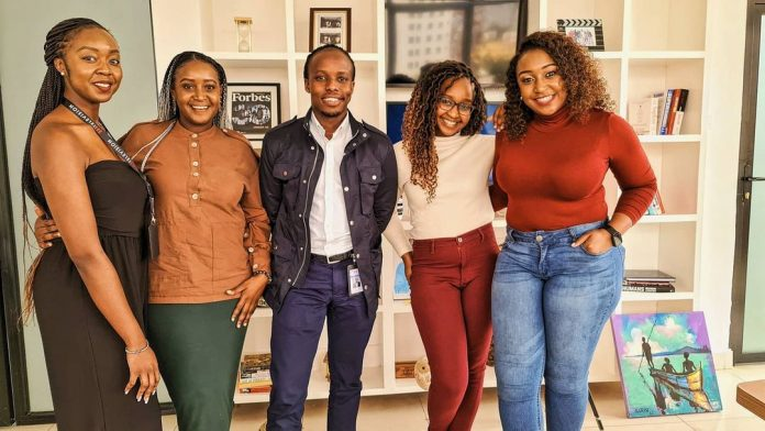 Film-maker Eugene Mbugua (centre) poses with Betty Kyallo (far right) and her sisters Gloria and Mercy after a meeting on July 15, 2021 to discuss her new reality show.