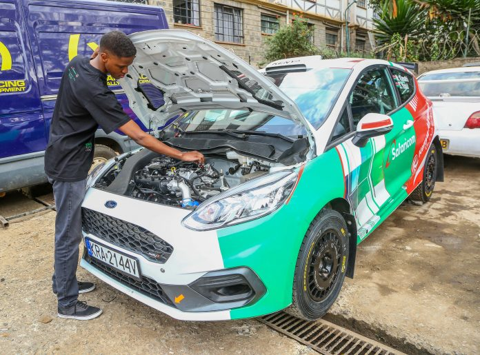 McRae Kimathi inspects the engine car in preparation for the African Rally Championship to be held in Tanzania from 23rd – 25th July, 2021.