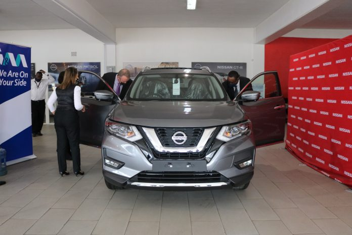 I&M Bank Limited CEO Mr. Kihara Maina (R) and Crown Motors Group Managing Director, Tony Voorhout (L) viewing the Nissan Xtrail vehicle, at the launch of the partnership between the companies, where the Bank will provide up to 100% Asset Financing to its customers for Crown Motors Group vehicles at competitive interest rates, extended repayment periods of up to 5 years, an enriched comprehensive motor insurance package at a discounted premium rate, Insurance Premium Financing and a two-month repayment holiday.