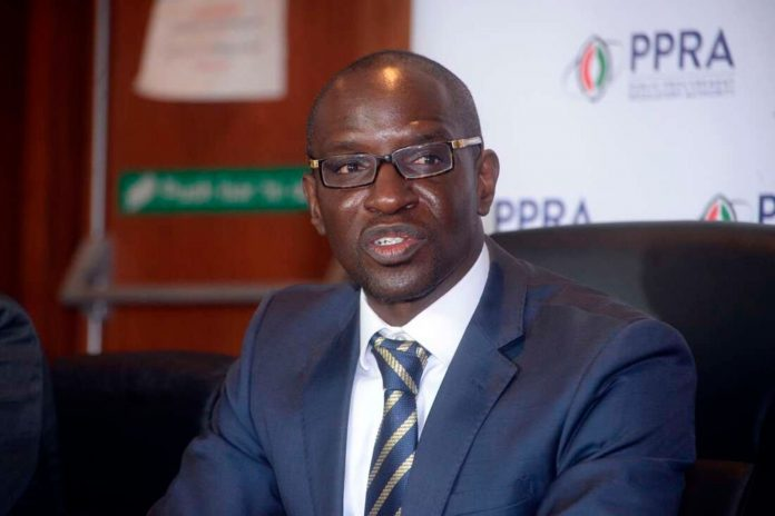 Andrew Mukite Musangi addressing a past press conference at the Public Procurement Regulatory Authority (PPRA), which he chairs.