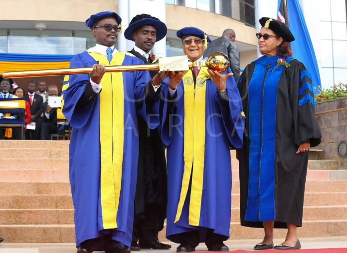 Outgoing Vice Chancellor Prof. Paul T. Zeleza (left) receiving the university mace from Chancellor Dr Manu Chandaria (second right) in 2016. Looking on is the former Chair of the Board of Trustees Mr. Linus Gitahi (second left) and former Vice Chancellor Prof. Freida A. Brown (right) who returns for a 9-month stint.