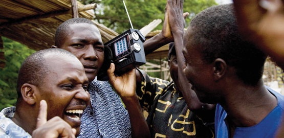 Citizens in Kisumu listening to a radio broadcast. The Communications Authority sought to remind broadcasters that any airing of gaming activities (betting, lotteries, and prize competitions/promotions) on broadcasting platforms must fully comply with the relevant provisions ofthe Programming Code. [Photo/ BBC]