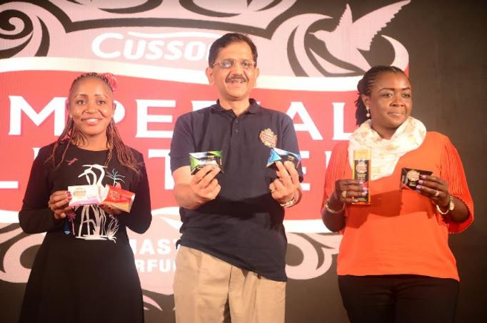 Ruth Wangombe, Imperial Leather Brand Manager (left) Sekar Ramamoorthy PZ CUssons Managing Director (center) and Hafsa Authur PZ CUssons Head of Marketing display some of the new variants for men during the official launch.