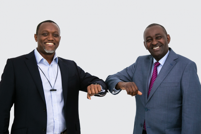 Sterling Capital CEO David Ngaine (L) poses with EGM Securities Chief Executive Samwel Kiraka after the firms unveiled a partnership to provide global trading opportunities for Kenyans to trade top-performing global stocks, as well as other asset classes such as indices and commodities like gold and oil.