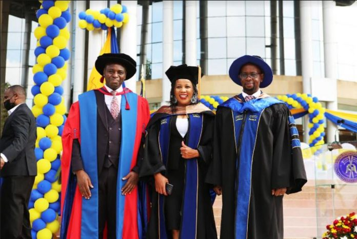 From left: Dean, School of Graduate Studies, Research and Extension, Prof. Amos Njuguna, Dr. Faith Mwende Linge (Doctor of Administration) and Dr. Peter Kiriri, Professor of Marketing, USIU-Africa during the University's 43rd Commencement ceremony held on September 25, 2021.