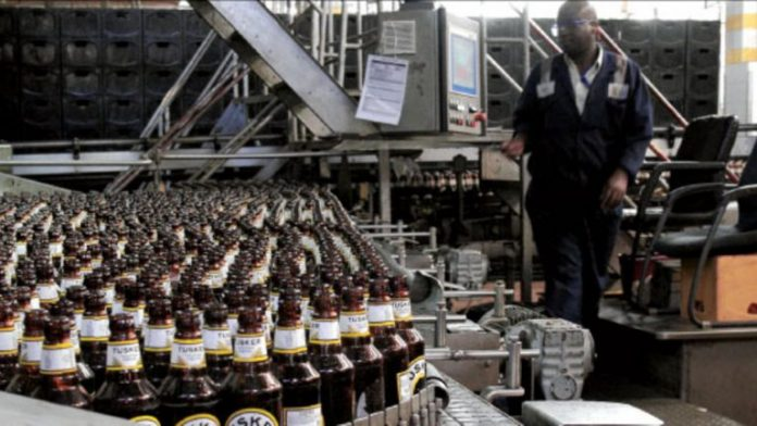 A bottling line at the East African Breweries Limited plant in Ruaraka, Nairobi. has notably been making a series of recent investments in renewable energy for its plants. [Photo/ Phoebe Okall]
