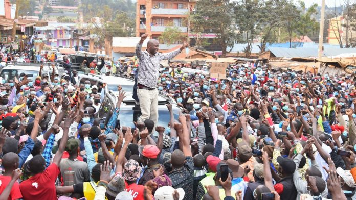 Murang'a Senator Irungu Kang'ata interacts with the crowd at a roadside rally on September , 2021 when he accompanied Deputy President William Ruto on a trip to Nyeri County. Ahead of the polls in 2022, heightened political activity has been witnessed in the country. [Photo/ @WilliamsRuto]