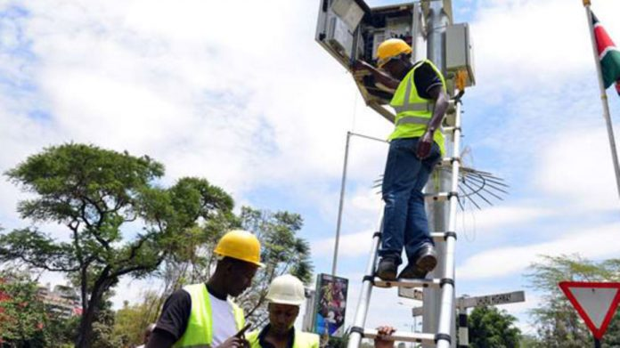 Ericsson Limited technicians repair a CCTV camera installed by Safaricom along Wayaki Way, Nairobi, in October 2015. The smart electricity meter project is the latest diversification opportunity for Safaricom, which has capitalized on its status as the leading network service provider for multi-billion shilling partnerships. [Photo/ NMG]