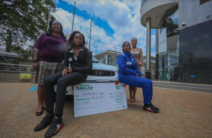 Rally Driver Maxine Wahome (R) and her co-driver Linet Ayuko (L) pose for a picture after Safaricom's sponsorship cheque handover.